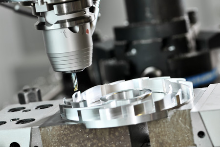 Milling cutting metalworking process. Precision industrial CNC machining of metal detail by mill at factory Stock Photo - 57363010