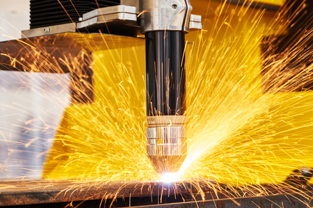 metal processing: plasma or laser cutting metalwork. Technology of flat sheet metal steel material processing with sparks