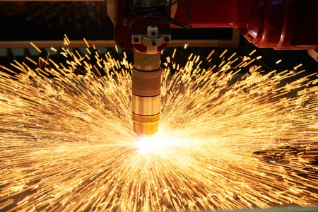 spark: plasma or laser cutting metalworking. Technology of flat sheet metal steel material processing with sparks Stock Photo