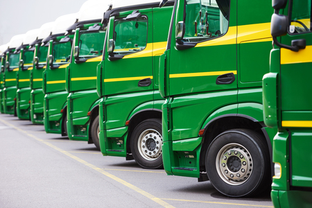 transporting freighting service company. commercial logistics delivery lorry trucks in row