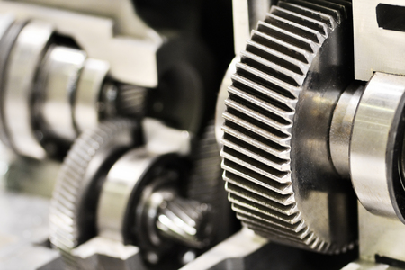 gearing: close-up metal cog wheels in gearing at gear box