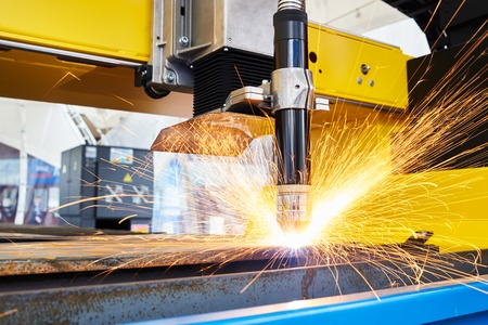 sheet metal: plasma or laser cutting metalwork. Technology of flat sheet metal steel material processing with sparks