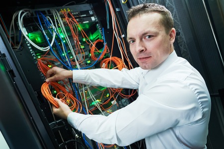 network engineer technician worker admin during server administration at data center room