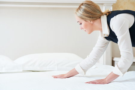hotel worker: Hotel service. Made making bed linen in room
