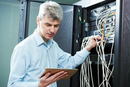 ADMIN: network engineer admin or server administrator technician worker at data center room Stock Photo