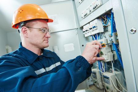 electrician screwdriver repair or fixing high voltage stock photo electrician screwdriver repair or fixing high voltage switching electric actuator in fuse box