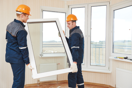 two windows installation workers installing double-glass pane Reklamní fotografie - 60846287