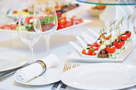 Catering service. set table with food, glassware and tableware