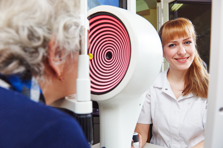 Optometry and ophthalmology. senior woman patient under sight testing or eye examinations in clinic Stock Photo