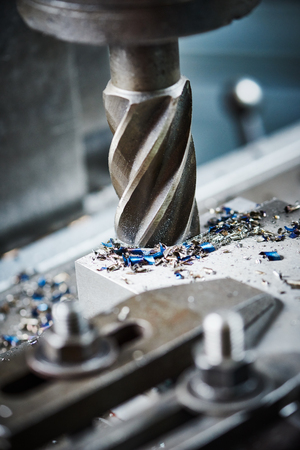 machine tool: industrial metalworking machining cutting process of blank detail by milling cutter at factory
