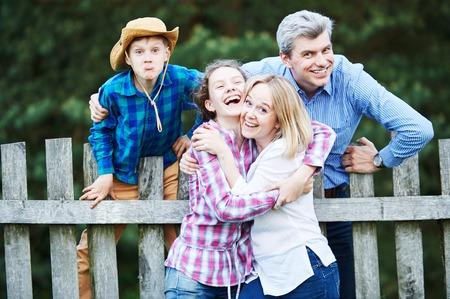 Family ralationship. Cheerful joyful man, woman and children having fun outdoors