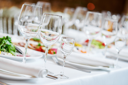 Catering services. glasses set and dish with food meal in restaurant 版權商用圖片