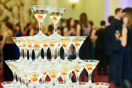 wedding party: Champagne pyramid with waitress on event, party or wedding banquet reception Stock Photo