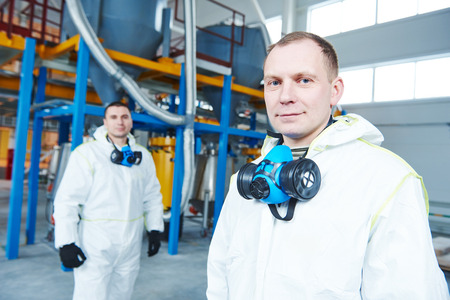 petrochemical: two chemical industry workers at industrial factory