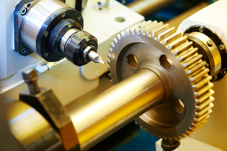 manufacturing equipment: metal working. Process of tooth gear wheel finish machining by cutter tool at factory