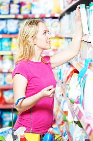 woman shopping toiletries and household cleaning supplies goods. Stock Photo
