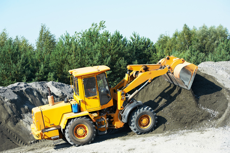 heavy wheel loader excavator machine loading gravelat quarry Stock Photo