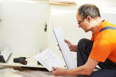marking up: Craftsman carpenter worker at kitchen furniture set installation service work Stock Photo