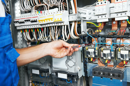 meter box: electrician measure high voltage with electrical tester meter in fuse box