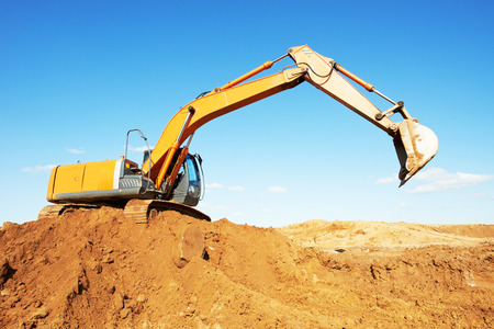 heavy loader excavator machine loading gravelat quarry Stock Photo