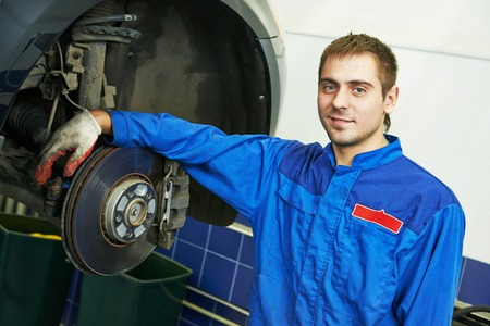 scheduled replacement: auto repairman mechanic portrait in car auto repair or maintenance shop service station
