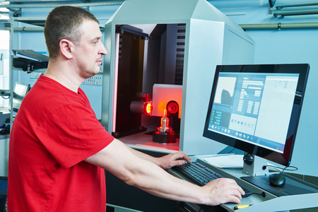 machine operator: manufacture worker at factory metal machining shop Stock Photo