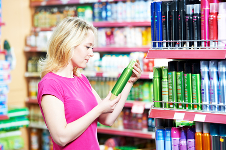 woman shopping air freshener, deodorant and household cleaning supplies goods.