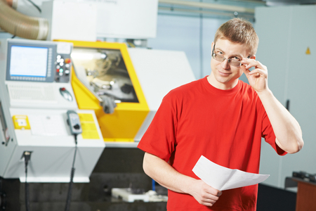 ncc: manufacture worker portrait at industrial factory metal machining shop