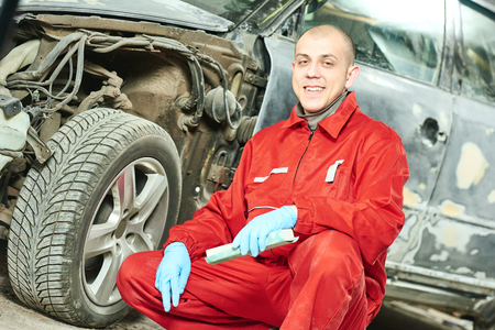 body work: auto mechanic worker portrait car body work at automobile repair and renew service station shop Stock Photo