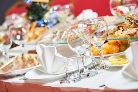 Catering services. glasses set and dish with food meal in restaurant Stock Photo