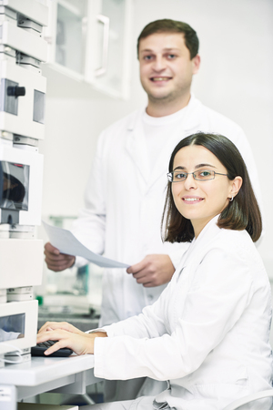 Portrait of pharmaceutical scientific researchers team workers at pharmacy industry manufacture factory laboratory Stock Photo