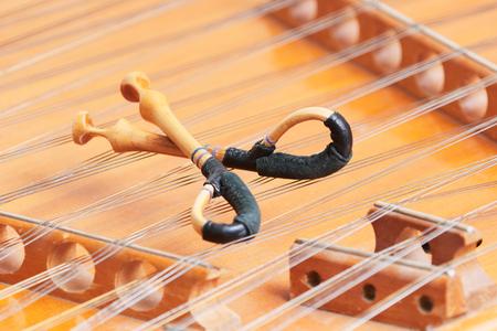 fingering: dulcimer cimbalom stringed musical instrument with hammers Stock Photo
