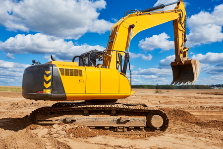 mining site excavator machine loader ready to earthmoving works construction works at sand quarry Stock Photo