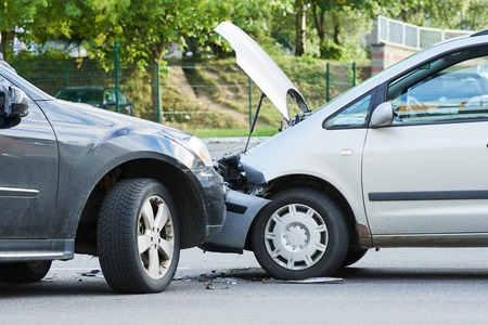 damaged car: Car crash accident on street with wreck and damaged automobiles after collision