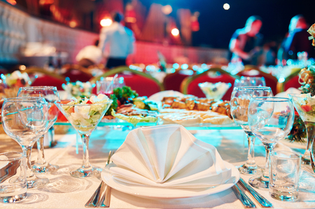 Catering service. Restaurant set table with food at event. Natural authentic shot in challenging light condition.