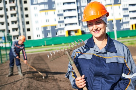 Portrait of happy municipal construction landscaper worker making urban improvement, landscaping and beautification Stock Photo