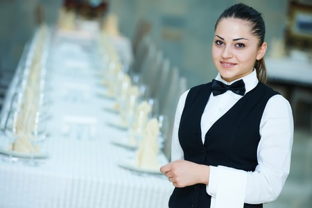 woman bar: waiter occupation. Female waitress at restaurant catering service. Stock Photo