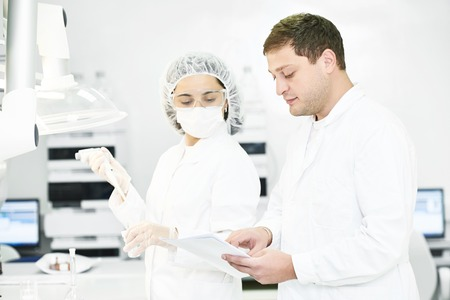 Portrait of pharmaceutical scientific researchers team workers at pharmacy industry manufacture factory laboratory Standard-Bild
