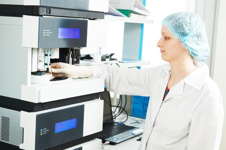 chromatograph: Pharmaceutical scientific researcher analyzing liquid chromatography data at pharmacy industry manufacture factory laboratory