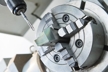 metalworking industry. Thread making by cutting screw tap on modern cnc metal working machining center