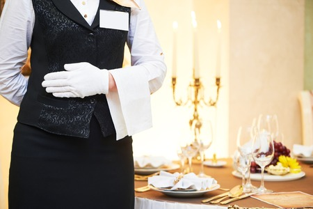 waiter occupation. Female waitress at restaurant catering service. 免版税图像