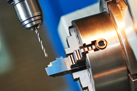 swarf: metalworking industry. drilling a hole on modern cnc metal working machining center