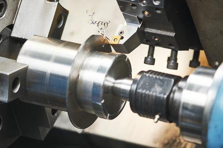 metalworking industry. cutting tool processing steel metal detail on turning lathe machine in workshop