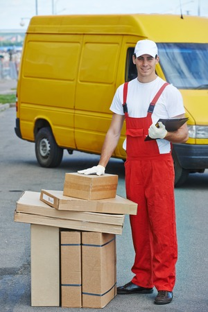 post man: Postal delivery courier man in front of cargo service van delivering package carton box