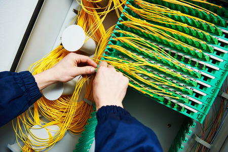 internet connection. technician engineer hands connecting fiber optic cables