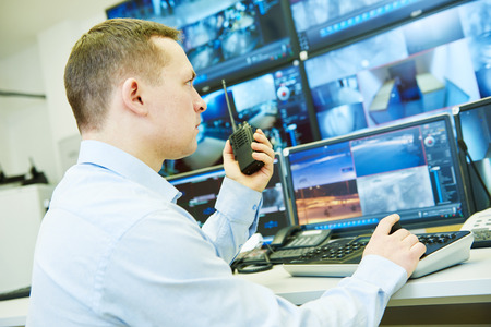 Surveillance security. Guard officer watching video monitoring system