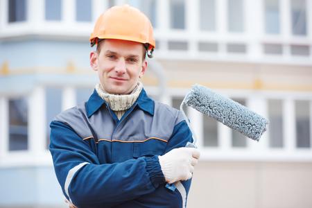 builder worker facade painter portrait with roller