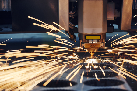 metalworking: plasma or laser cutting metalworking. Technology of flat sheet metal steel material processing with sparks Stock Photo