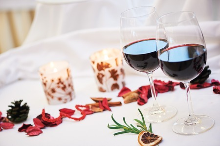 table decoration: Catering restaurant service. table decoration with glasses of wine and candles at event.