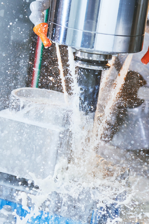 metalworking: Milling metalworking process. Industrial CNC machining of metal detail by cutting end-tooth vertical mill at factory Stock Photo